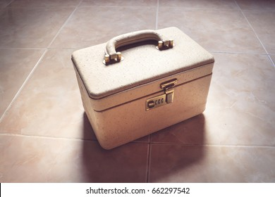 Combination lock and handle of a yellow colored suitcase
