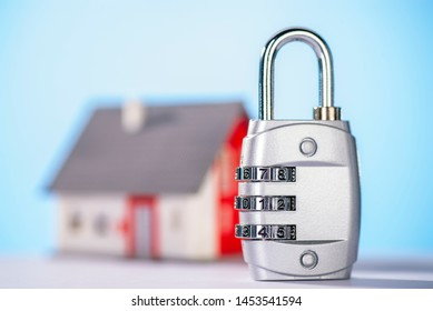 Combination lock with house in the background
