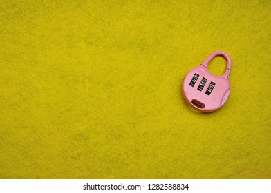 A combination padlock on a yellow background