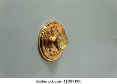 Combination safe lock, in golden duotone.