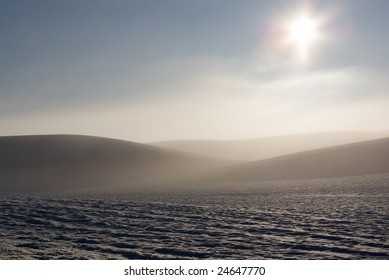 A combination of snow, fog and late afternoon sun gives an almost out of this world look to this shot.