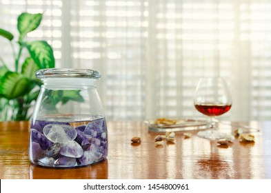 Combination of two stones used in the preparation of gem elixir. Amethyst and clear quartz are placed into a glass jar filled with clean water. This homeopathic remedy helps to get over the hangover.