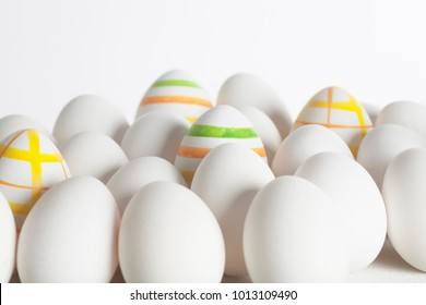 a combination of white and colored eggs