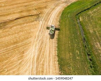 combine harvester - aerial view drone shot of two of the biggest combine harvester at harvesting golden ripe wheat field in germany