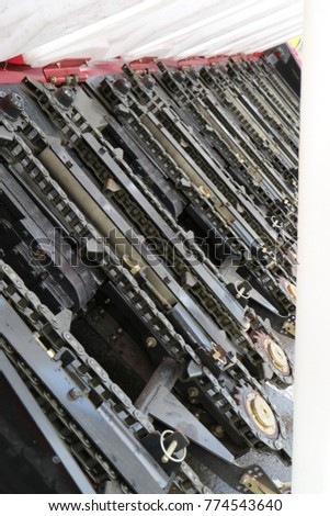 Combine Harvester Black Metal Chainsaws Arranged Stock Photo