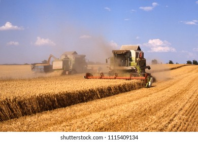 combine harvester while harvesting on sunny day