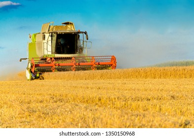 Combine harvesting in a field of golden wheat