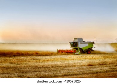Combine harvesting rape on farmlad.