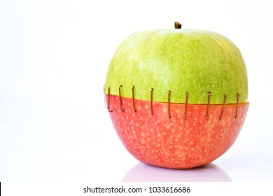 Combine the top of a green apple with the buttom of a red one by sew them together
