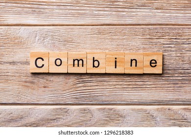 COMBINE word written on wood block. COMBINE text on wooden table for your desing, concept.
