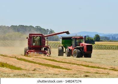 Combine working a newly cut field of summer wheat in the Willamette Valley of Oregon