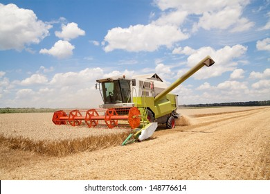Combine working on a wheat field