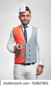 Combined collage shot of a handsome young man dressed in elegant classic business outfit and a safety vest with hardhat on the other side holding architectual blueprints profession engineering.