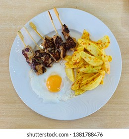 Combined dish with roman spikes, fried egg and potatoes