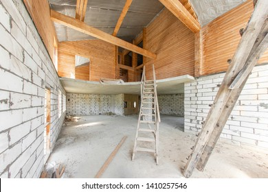Combined house of wooden beam logs and bricks. The first floor of the house. overhaul and reconstruction. House or apartment is under construction, remodeling, renovation, restoration.