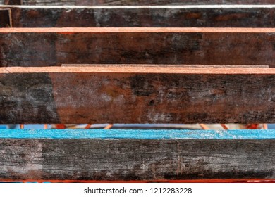 the combined texture of wooden boards closeup with indistinct and with sharp elements for an abstract background