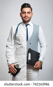 Combined vertical studio shot of a doctor and young businessman profession occupation career job professionalism helpful friendly experienced confident uniform knowledge healthcare manager.
