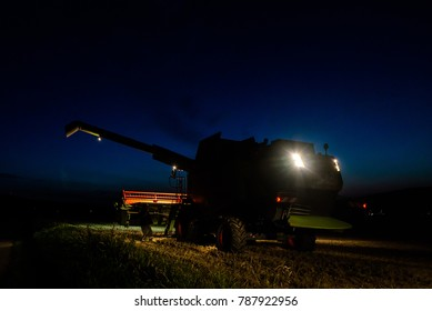 combine-harvester working at night