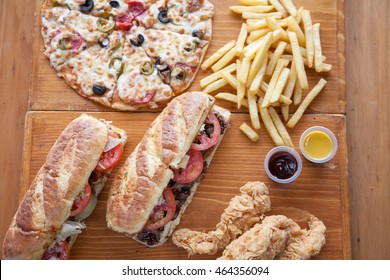 Combo meal sub sandwiches pizza chips chicken strips aerial shot
