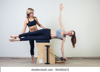 combo wunda pilates chair woman with instructor fitness yoga gym exercise.