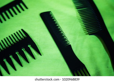 combs for haircuts and linings on a green background