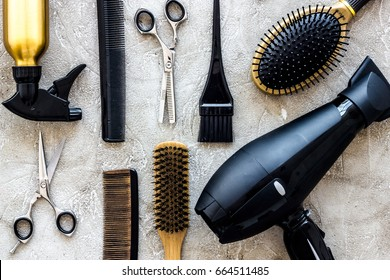 Combs and hairdress tools on stone table background top view