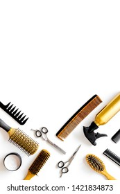 Combs, sciccors and hairdresser tools in beauty salon work desk on white background top view space for text