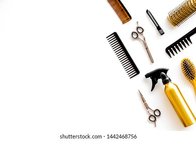 Combs, spray and hairdresser tools in beauty salon work desk on white background top view mockup