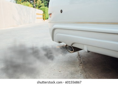 combustion fumes coming out, black smoke of sport car exhaust pipe