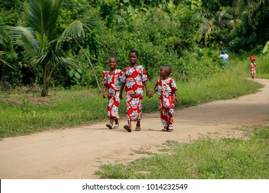 Come Benin April 20 2014 Easter party in village in Benin. Unknown Children dressed in new clothes are walking to the Easter party