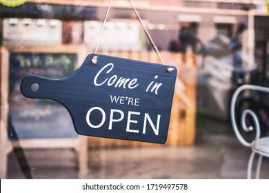 Come in we're open, vintage black retro sign in restaurant