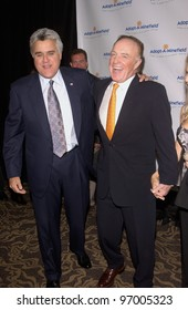 Comedian JAY LENO (left) & actor JAMES CAAN at the 4th Annual Adopt-A-Minefield Gala at the Century Plaza Hotel, Beverly Hills, California. October 15, 2004