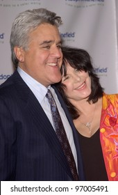 Comedian JAY LENO & wife MAVIS at the 4th Annual Adopt-A-Minefield Gala at the Century Plaza Hotel, Beverly Hills, California. October 15, 2004