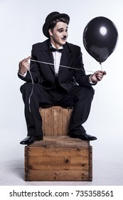 Comedian mime and a black balloon