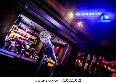 Comedy or Music Show at Night with  Microphone and Blue Lights Nightlife.