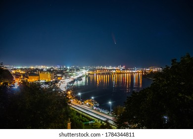 Comet C/2020 F3 (NEOWISE) at night over the city. Kyiv. Dnieper River. Ukraine.