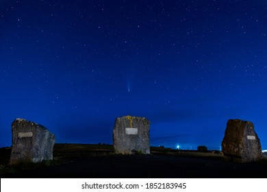 Comet Neowise over the Aneurin Bevan monument stones on the hillside between the towns of Ebbw Vale and Tredegar in South Wales
