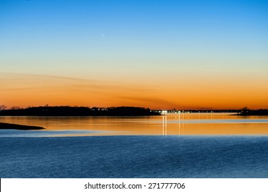Comet Panstarrs Sunset across a lake