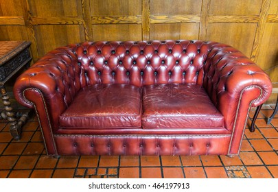 comfort, antique furniture and interior concept - close up of vintage leather sofa