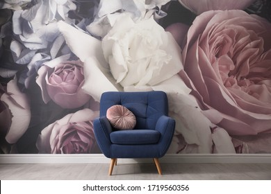 Comfortable armchair near wall with floral wallpaper. Stylish living room interior - Shutterstock ID 1719560356