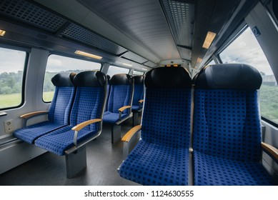 Comfortable and beautiful blue seats in the train. Transport. Travels.