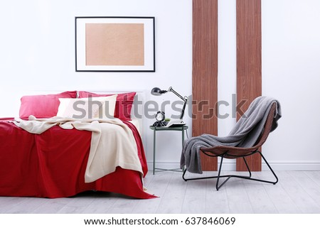 Comfortable bed burgundy bedding modern interior stockfoto jetzt
