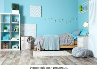 Comfortable bed in modern children room