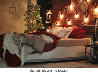 Comfortable bed with pillows in room