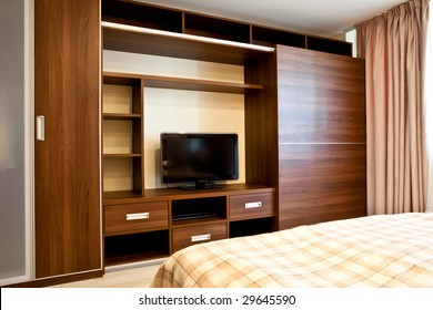 Comfortable bedroom with TV and wardrobes