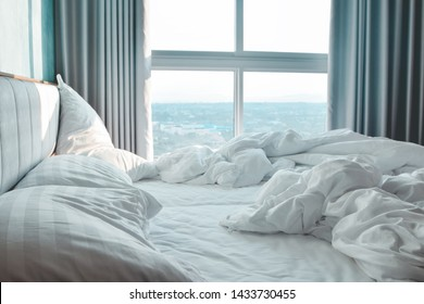 Comfortable bedroom,messy bedding sheets and duvet with wrinkle messy in the bedroom