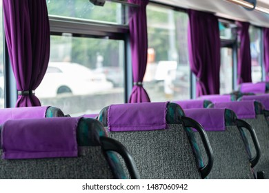 Comfortable bus seats backs without passengers. Intercity coach services. New bus interior with seat belts on each place.