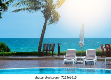 comfortable chair at the swimming pool, modern chair, sunlight on the picture, copy space.