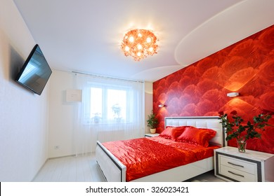 Comfortable and cozy white and red bedroom