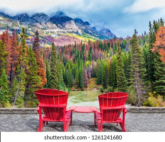 Comfortable deck chairs stand over the river and the forest. Rocky Mountains of Canada. The valley along the Pocahontas road. Concept of ecological, active and photo-tourism